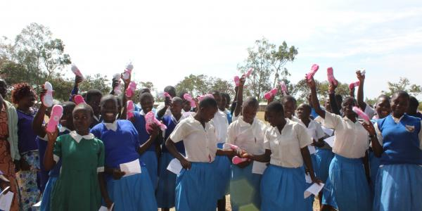 School girls holding Lilypads products